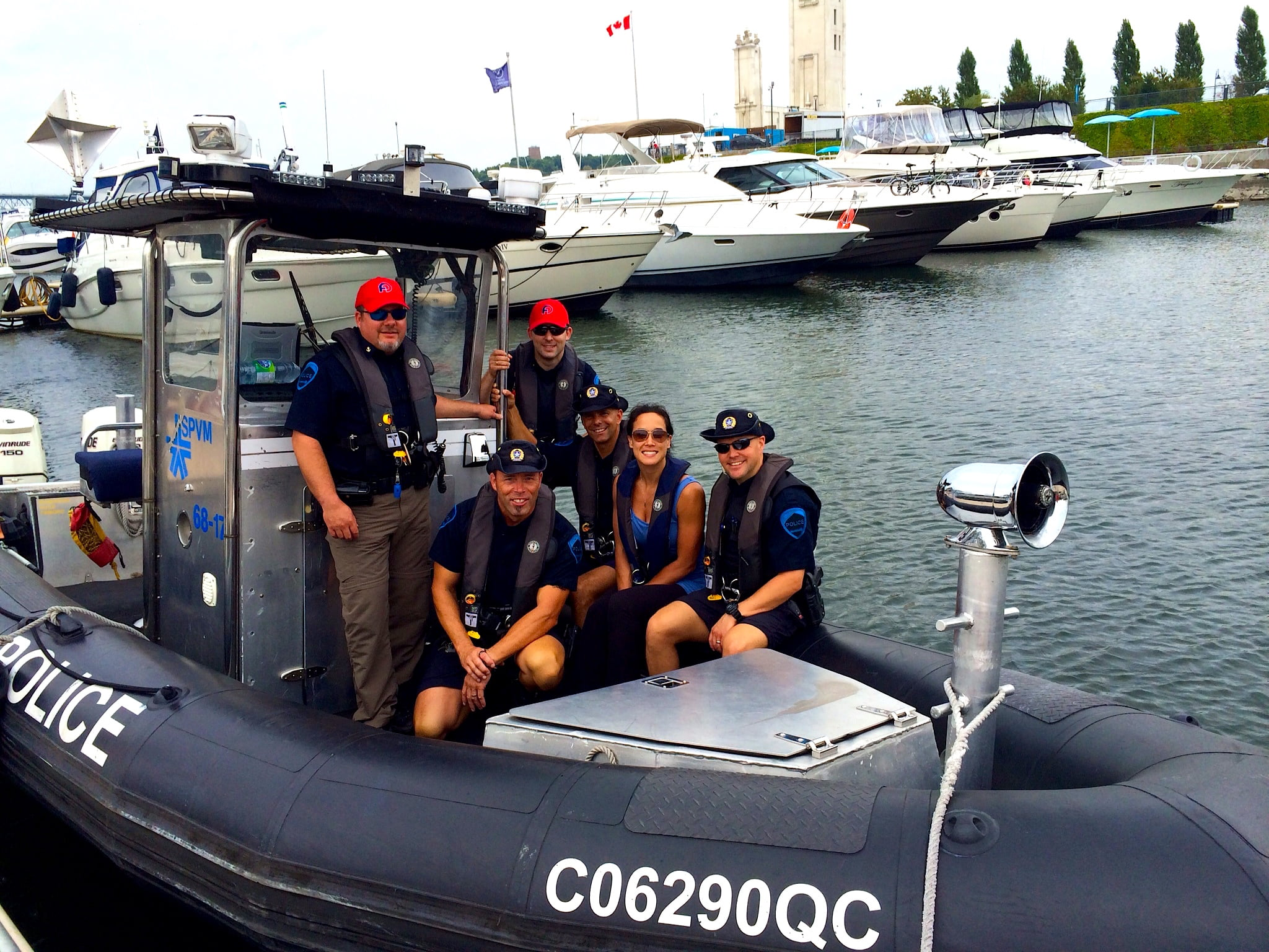 Officers Yannick Ouimet (on my left in the photo) with fellow members of the SPVM nautical division